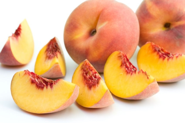 5344572 - fresh peaches on white background.