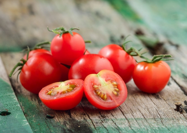 46517060 - close-up of fresh, ripe cherry tomatoes on wood