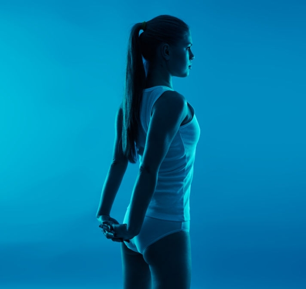 55392760 - scoliosis therapy concept. young sporty woman stretching body.