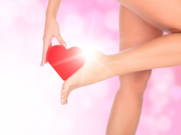 20077845 - female legs against a pink background with blurred lights