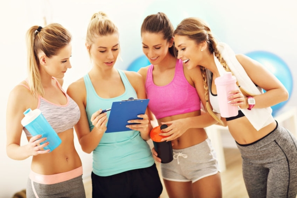 78309295 - young women group discussing health plan at the gym