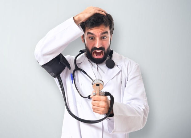 41314099 - frustrated doctor with blood pressure monitor over white background