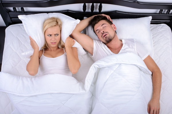31329341 - young woman cannot sleep through the snoring of her husband in bedroom