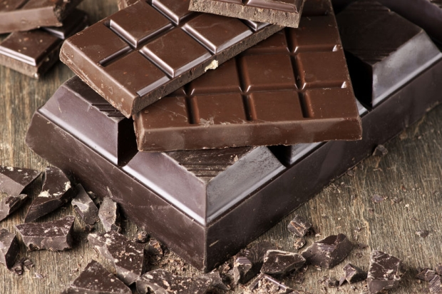 45834868 - assorted dark chocolate bars and chopped chocolate on vintage wooden background.