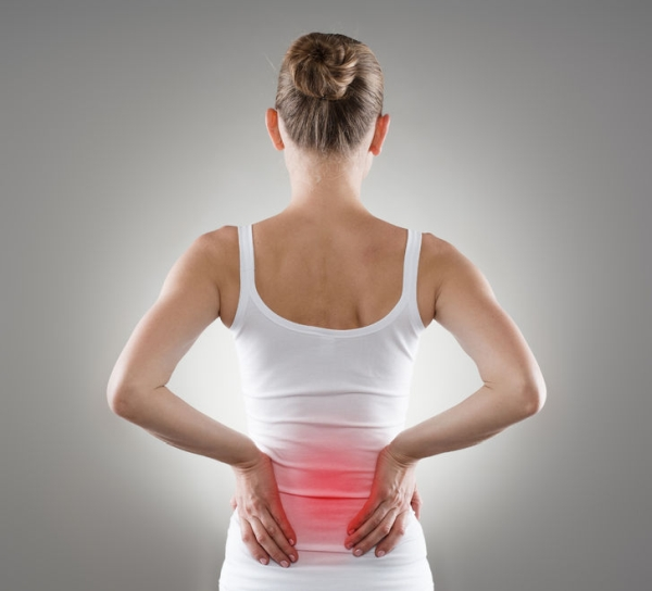 38045895 - loin spasm. young woman with hurt backbone. spine inflammation, pain and therapy.