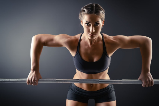 35802561 - strong young woman with beautiful athletic body doing exercises with barbell. fitness, bodybuilding. health care.
