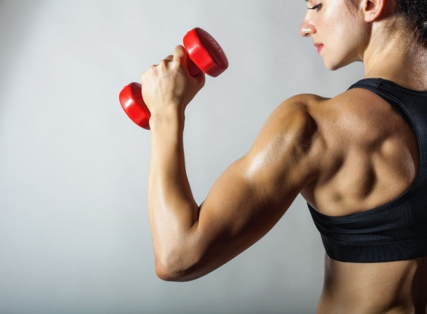 35452918 - fitness woman with barbells on grey background