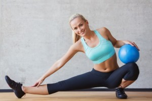 38675639 - fitness, sport, training and people concept - smiling woman with exercise ball in gym