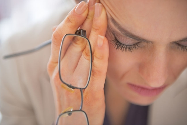 29947707 - closeup on stressed business woman with eyeglasses