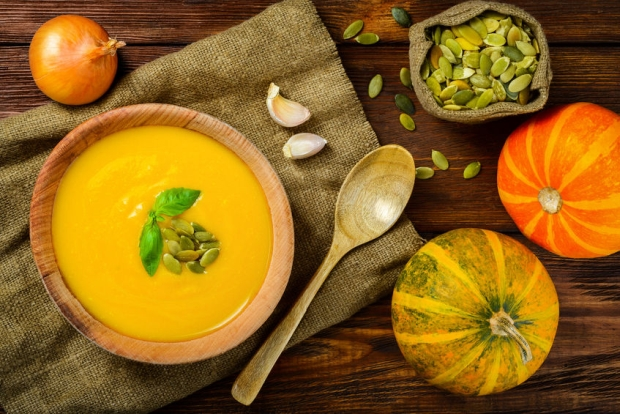 35597915 - homemade autumn butternut squash soup rustic wooden table
