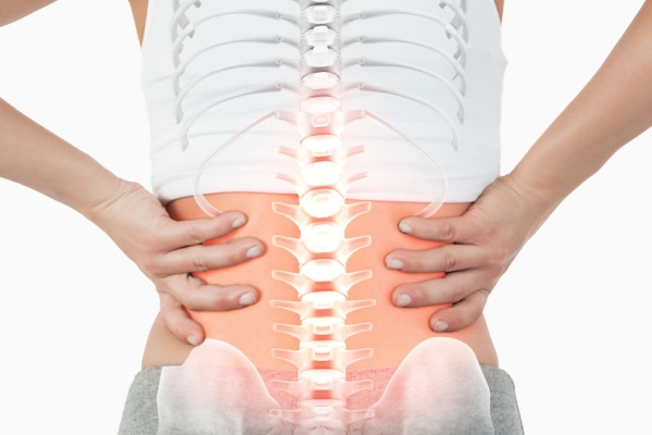 44776871 - digital composite of highlighted spine of woman with back pain