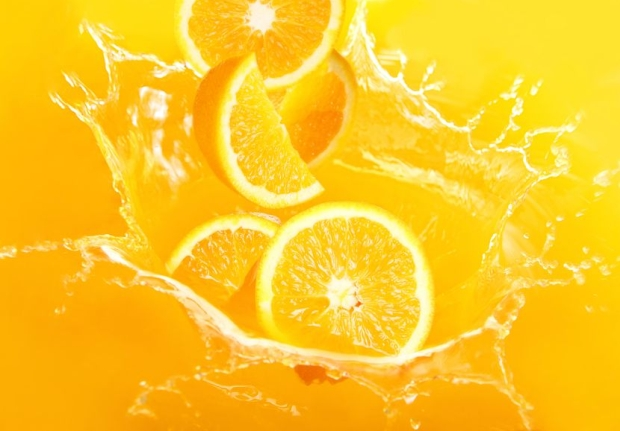 9860587 - fresh oranges falling in juice with lot of huge splashes