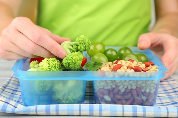 34825195 - woman making tasty vegetarian lunch, close up
