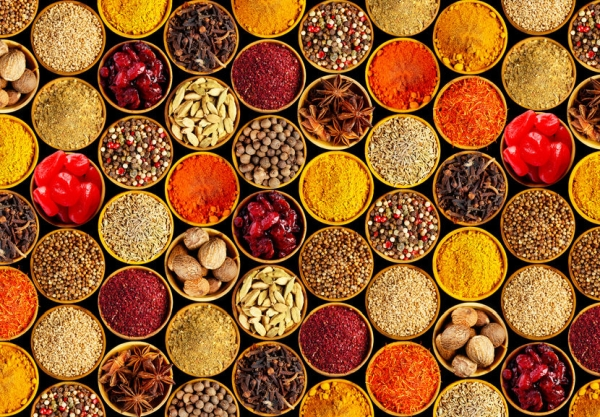 44452377 - different spices on black background