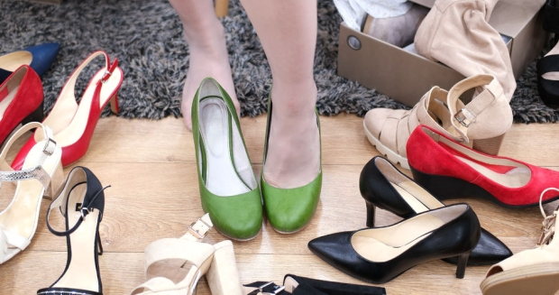 76533304 - woman chooses  shoes at fashionable shop