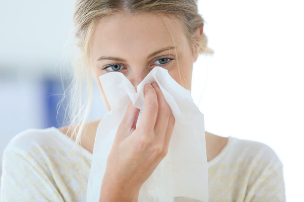 29733524 - young woman with cold blowing her runny nose