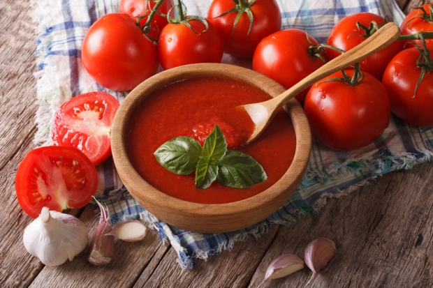 45030634 - homemade red tomato sauce with garlic and basil in a wooden bowl closeup. horizontal