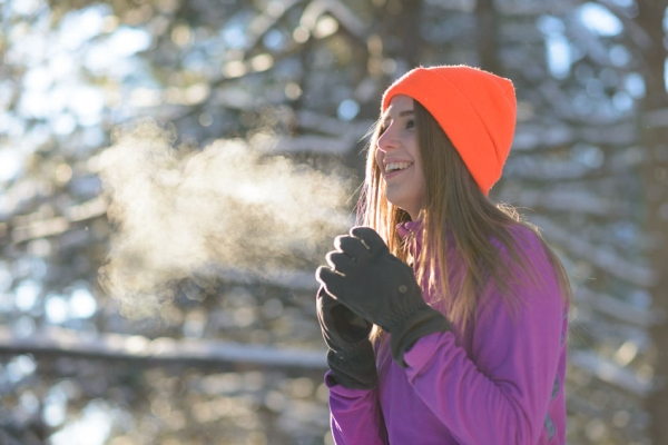 90449361 - young woman runner smiling in beautiful winter forest at sunny frosty day. active lifestyle and sport concept.