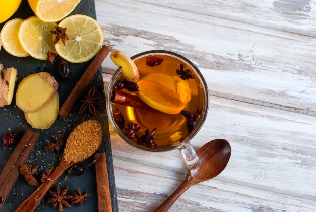 69896904 - lemon, ginger, korinevy sugar, cinnamon sticks and cardamom - ingredients for a spicy warming tea in the winter day, healthy eating concept