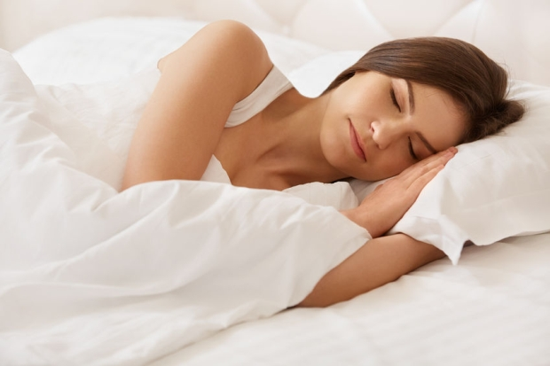45858530 - young beautiful woman sleeping on bed