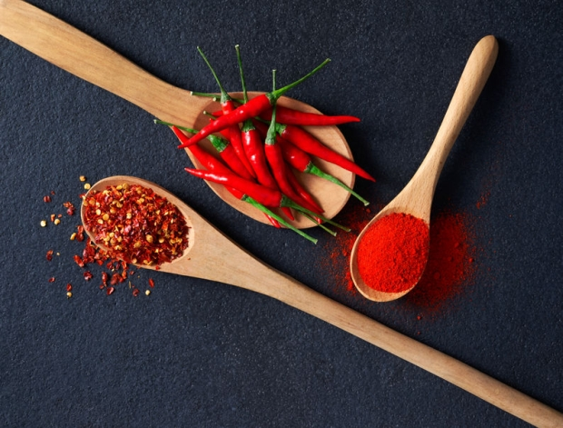 47773150 - wooden spoon filled with chilli, red pepper flakes and chilli powder