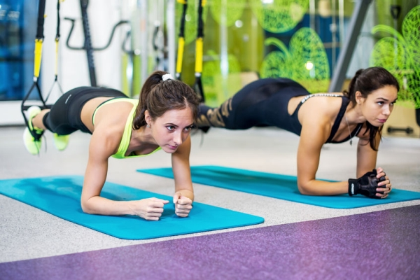 48212116 - fit girls in gym doing plank exercise for back spine and posture concept pilates fitness sport