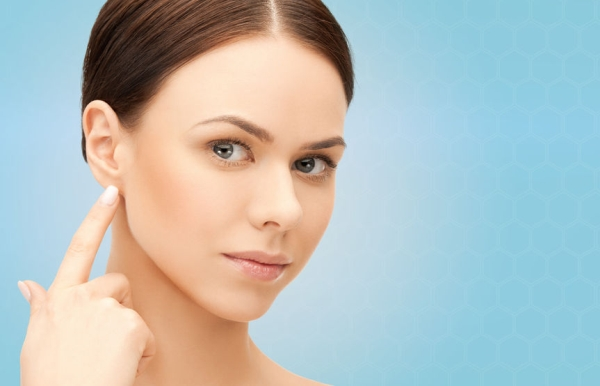 40263940 - people, beauty, hearing and healthcare concept - face of beautiful woman touching her ear over blue background