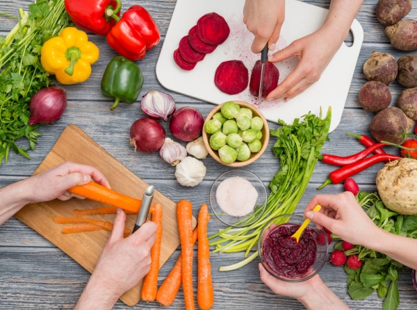 72952395 - cooking food kitchen cutting cook hands man male knife preparation fresh preparing hand table salad concept - stock image