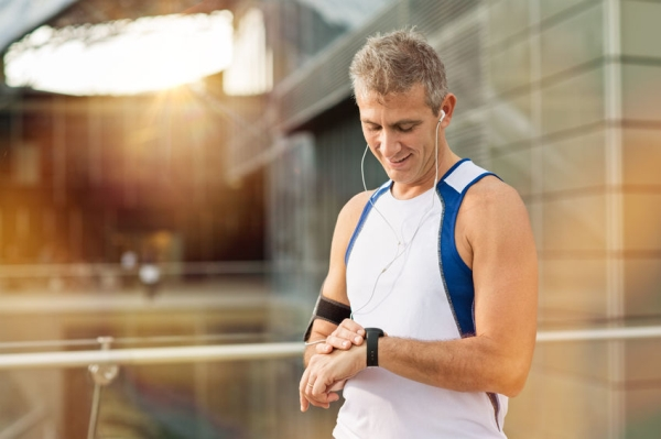 34239529 - portrait of happy mature man with heart rate monitor on wrist