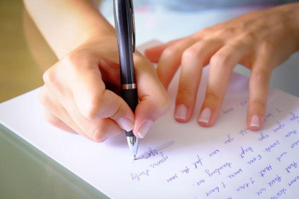 35362064 - writing a letter with a black pen