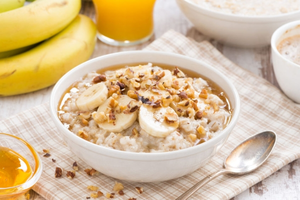 34657106 - oatmeal with banana, honey and walnuts for breakfast, close-up