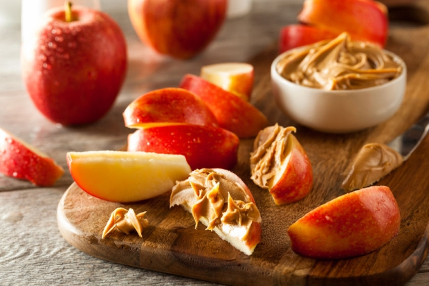 41479437 - organic apples and peanut butter to snack on