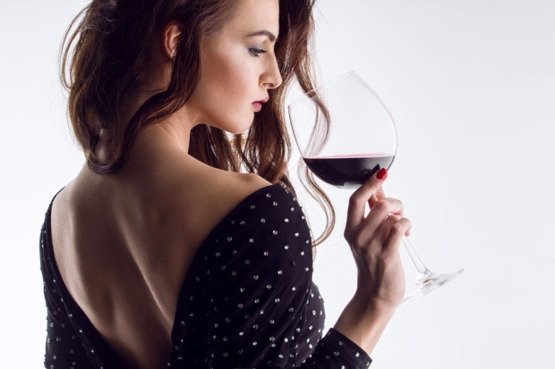 38689135 - young gorgeous brunette with glass of red wine