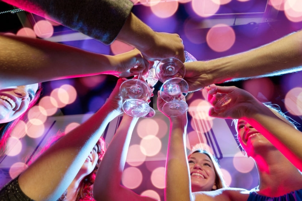 35026385 - party, holidays, celebration, nightlife and people concept - smiling friends with glasses of champagne in club
