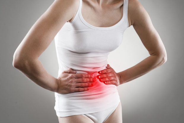38046948 - young female having stomachache. chronic gastritis. ulcer. abdomen bloating concept.
