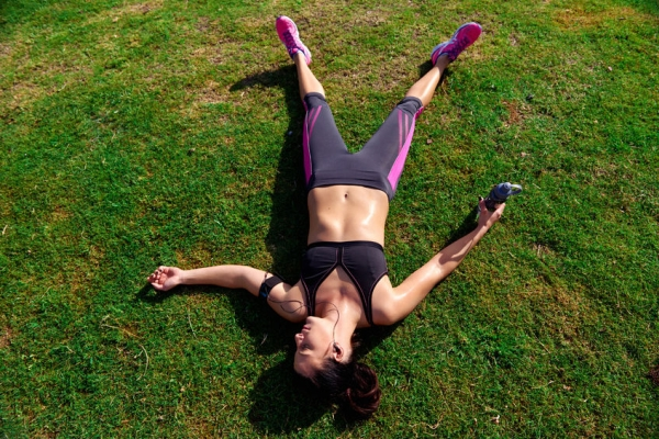33647552 - exhausted runner after fitness running workout catching breath