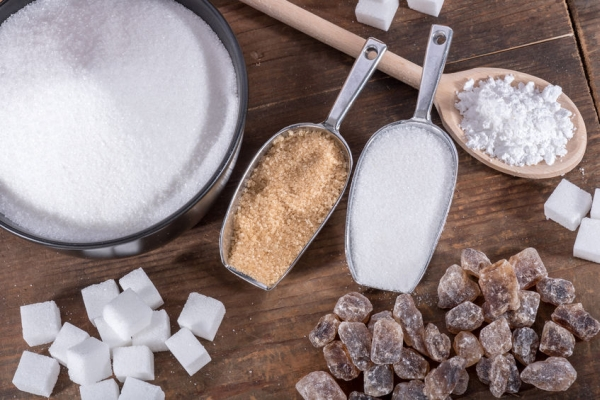 46726617 - composition of different types of sugar, on wooden background