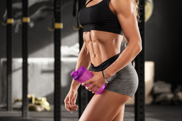 88298501 - fitness sexy woman showing abs and flat belly in gym. beautiful muscular girl, shaped abdominal, slim waist