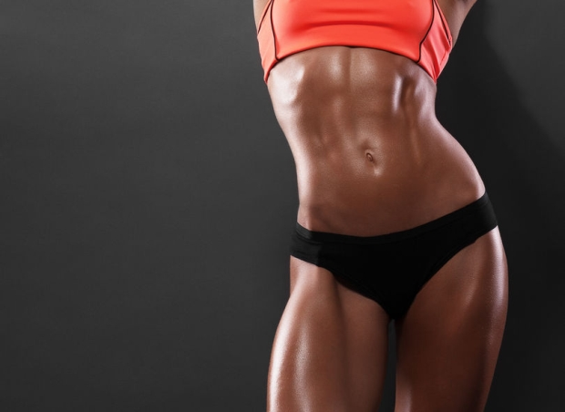 39447204 - close-up of the abdominal muscles young athlete on gray background