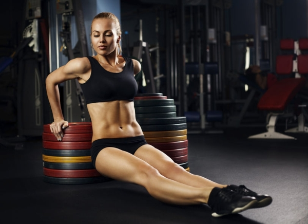 36065346 - beautiful muscular fit woman exercising building muscles