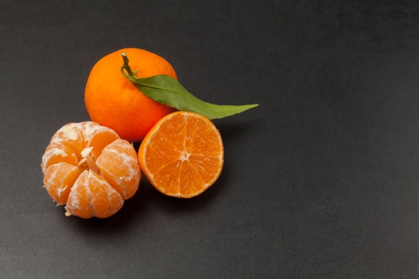 69507079 - tangerines on black background