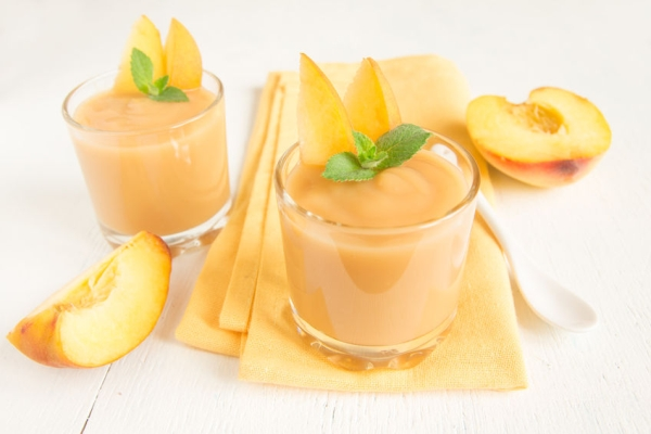 40935333 - peach smoothie dessert with mint on napkin, top view