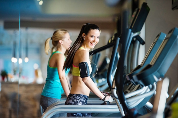 50986764 - two young beautiful women working out in gym
