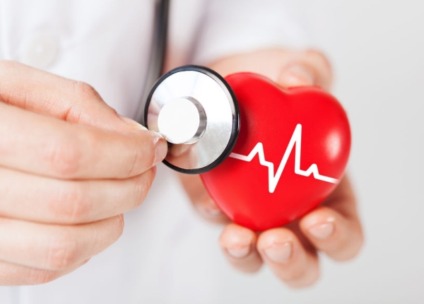 31573610 - healthcare and medicine concept - close up of male doctor hands holding red heart with ecg line and stethoscope