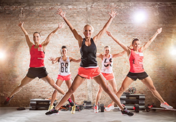 55301317 - group of sporty women doing jumping exercise