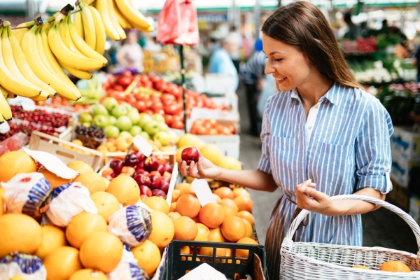 82324511 - picture of woman at marketplace buying fruits