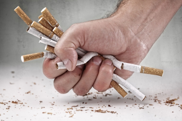 35905372 - man refusing cigarettes concept for quitting smoking and healthy lifestyle