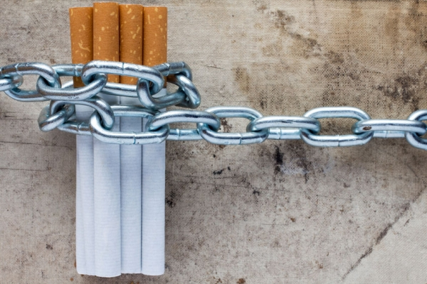 48607104 - chained cigarettes. conceptual image for stop smoking