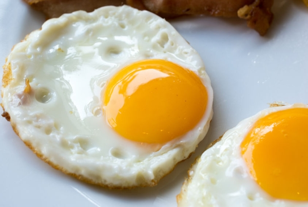 48675125 - fried eggs on a white plate