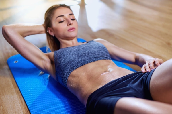 75613016 - girl on  floor doing exercises on the stomach in the gym.  wet body.